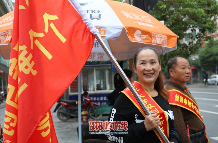 隆回100名老年志愿者服务文明卫生城